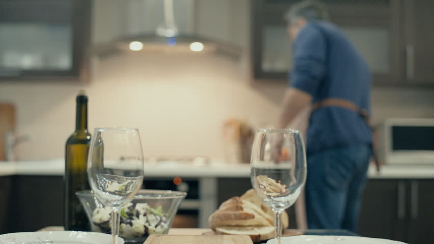 Man preparing supper for two persons. Romantic concept . | Shutterstock HD Video #1007536192