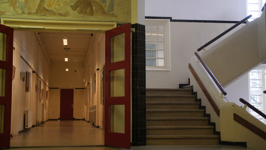 Empty hallway and staircase in high school building. | Shutterstock HD Video #1007560117