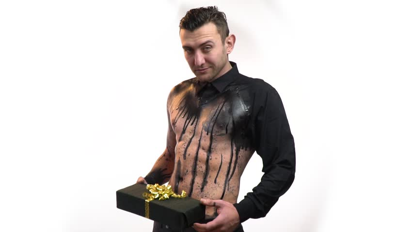 Sexy male stripper in black bodyart gets a gift