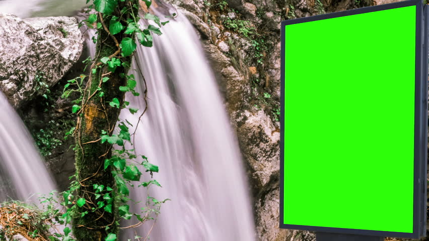 Billboard green screen near the Fabulous waterfall   Shutterstock HD Video #1007703997