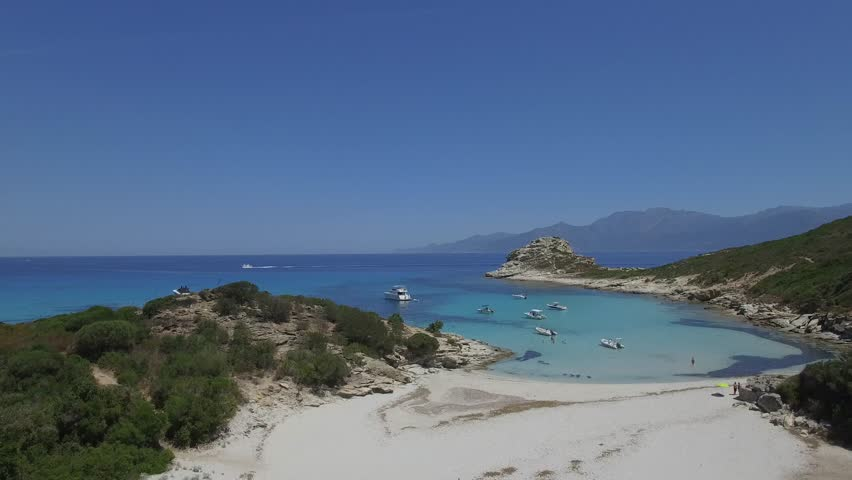Aerial view of paradise beach with white sand and turquoise crystal clear water of Mediterranean Sea - Pietra Island, Corsica