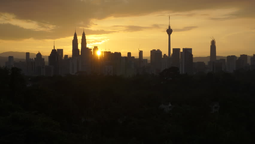 Time lapse of sunrise of Kuala Lumpur cityscape skyline in silhouette. High quality, HD, SOOC.
