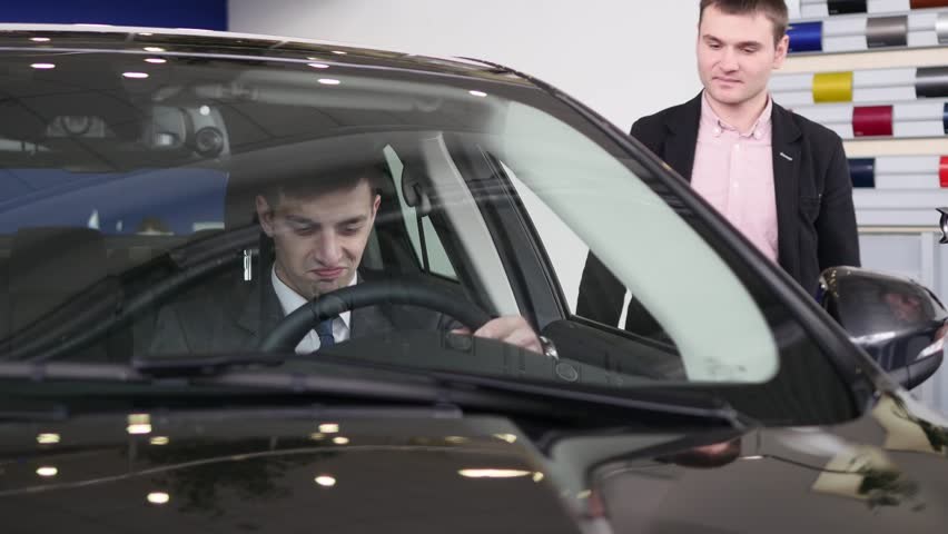Buyer having conversation with car seller during inspecting the car   Shutterstock HD Video #1007713831
