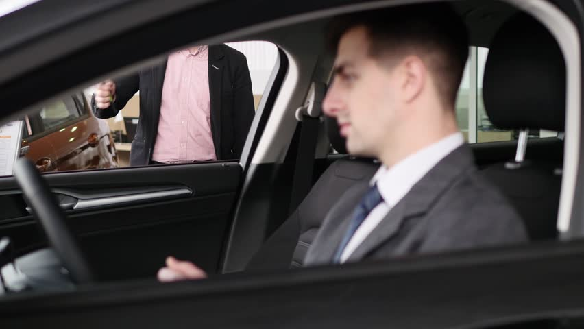 Buyer having conversation with car seller during inspecting the car   Shutterstock HD Video #1007713864