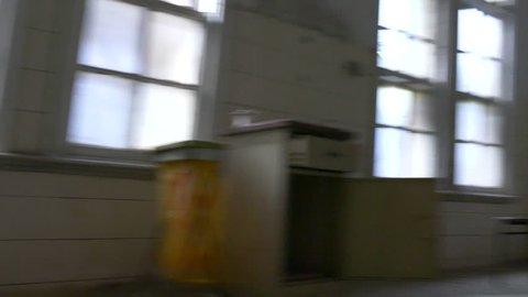 POV of insane person dreamlike spinning in asylum theater