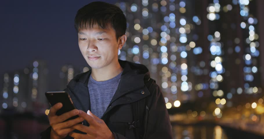 Asian man use of mobile phone in city in the evening | Shutterstock HD Video #1007738482