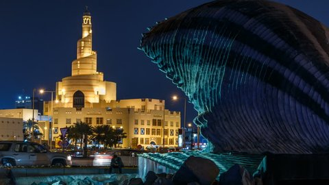 Qatar Islamic Cultural Centre night timelapse in Doha, Qatar, Middle-East. Traffic on the road. View from Corniche