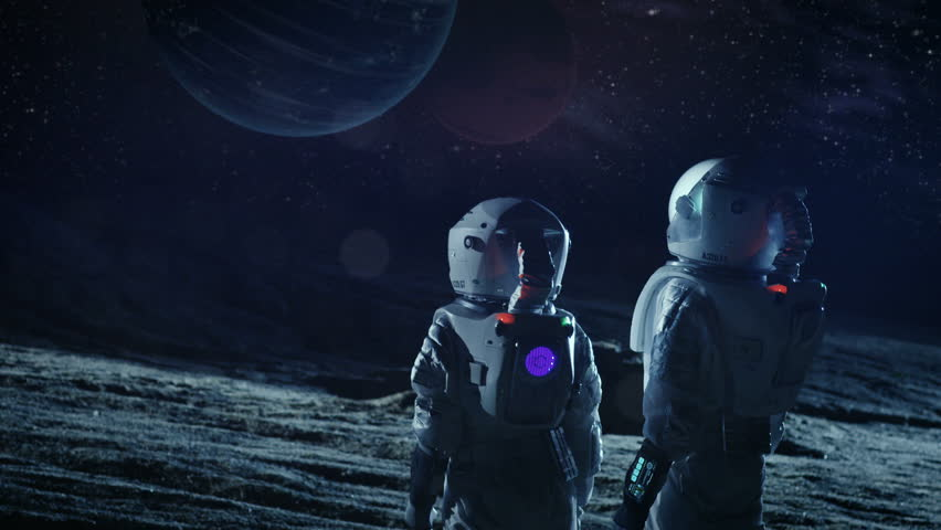 Two Astronauts in Space Suits Standing on the Alien Planet Look at Two Beautiful Planets in the Sky. Space Travel, Habitable World and Colonization Concept. Shot on RED EPIC-W 8K Helium Cinema Camera.