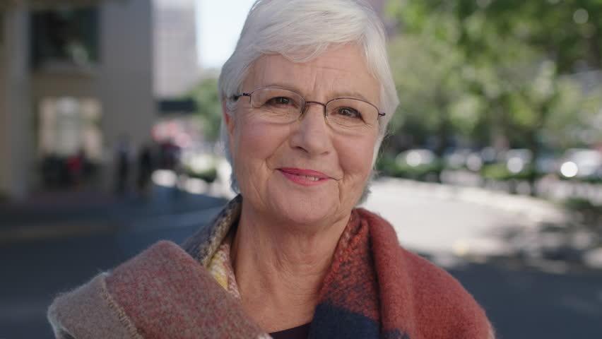 Beautiful portrait of elegant elderly woman smiling cheerful enjoying retired lifestyle healthy senior | Shutterstock HD Video #1007761612