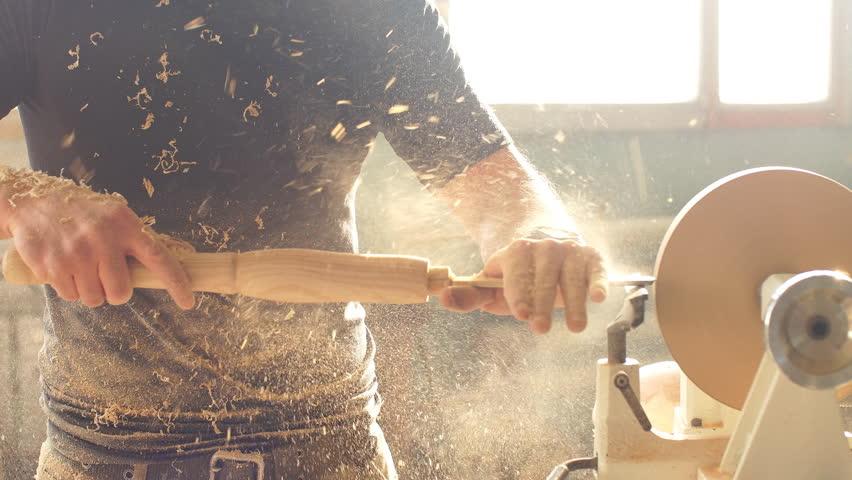 Carpenter scrape on the lathe a piece of furniture. | Shutterstock HD Video #1007783812