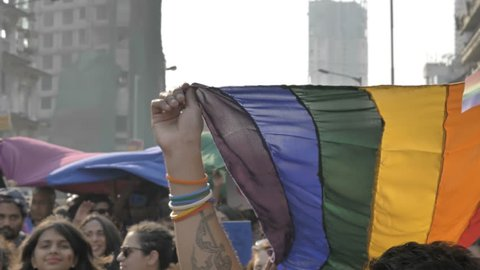 Supporters and participants of Gay or LGBT pride Parade waving colorful rainbow or pride flag, Mumbai, India (2018)