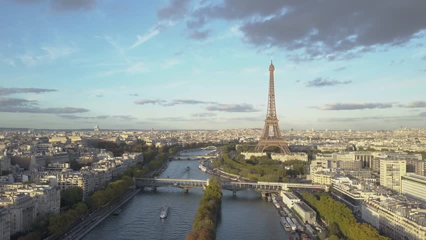 Aerial of Paris Eiffel Tower and Seine River. Train crossing the bridge | Shutterstock HD Video #1007822512