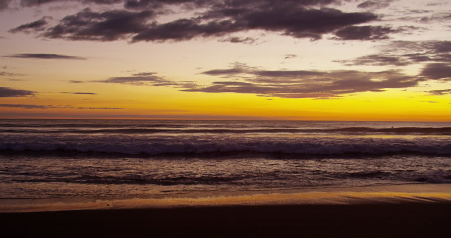 Sunset on the beach, waves. Pacific Ocean.