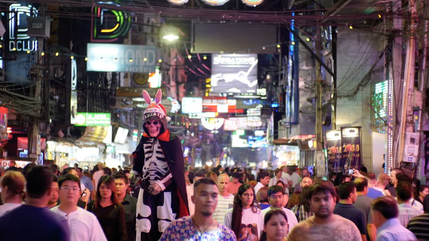 PATTAYA, THAILAND, DECEMBER 31, 2017: Famous Walking Street in Pattaya at night. Thailand. Crowd of people walking on red-light street. The street is a tourist attraction primarily for night life and