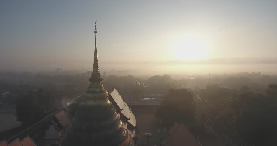 Cinematic Morning Aerial view of Wat Prathat Lampang Luang , Thailand Lampang Temple