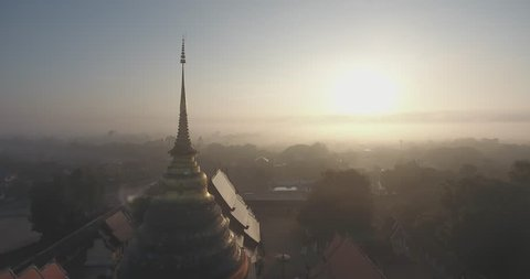 Cinematic Morning Aerial view of Wat Prathat Lampang Luang , Thailand Lampang Temple