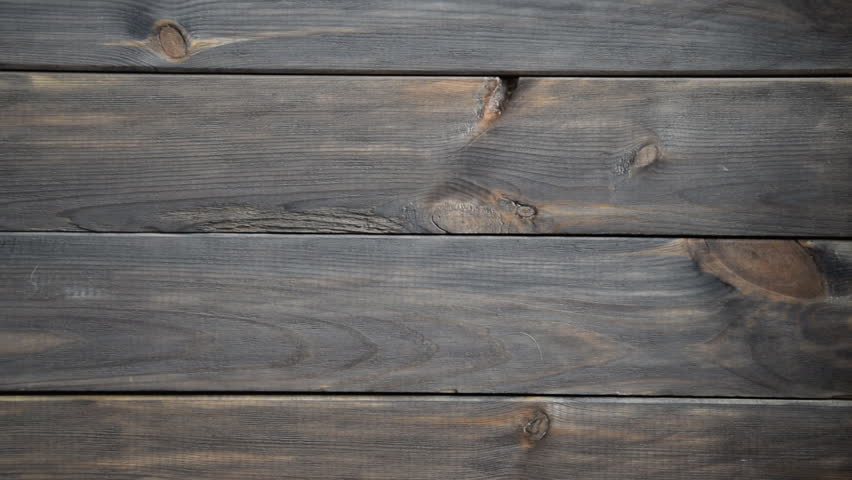 Real Old Wood Texture Vintage Background. Dark background. The camera moves from right to left.