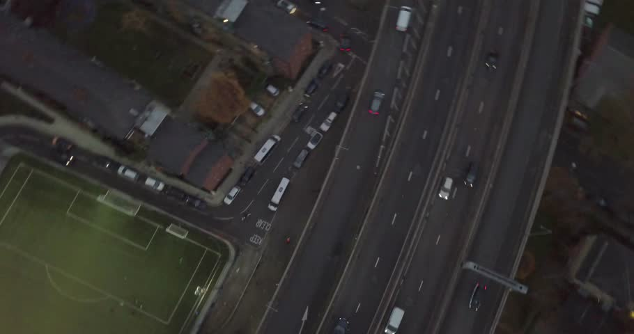 Captivating Overhead Follow Shot of Football Pitch Onto Busy London Evening Traffic Jam