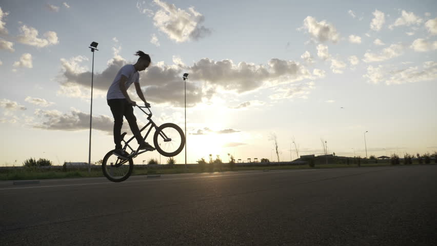 Slow motion of hipster young man losing control of bike failing jump trick | Shutterstock HD Video #1007937202