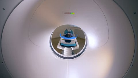 A view from inside of a working CT machine.