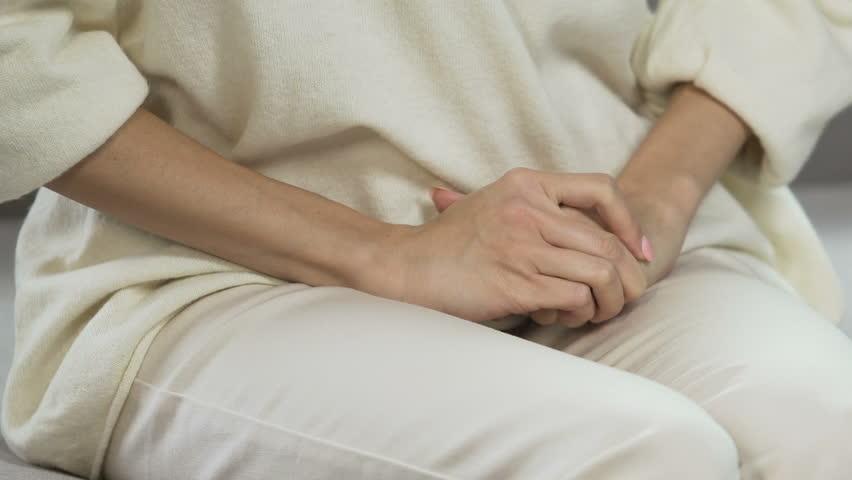 Female having stomach pain, period suffering, pregnancy problem, hands closeup
