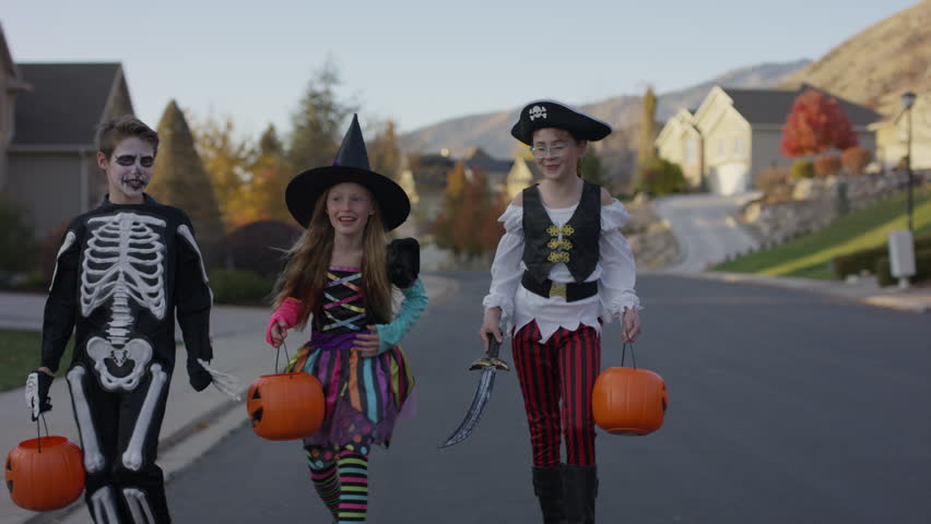 Front view tracking shot of children walking in neighborhood on Halloween / Cedar Hills, Utah, United States | Shutterstock HD Video #1007984602