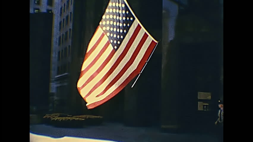 San Francisco, United States - in 1980: historic 555 California Street, Bank of America Center in 1980s. Officers lowering American flag at sunset. World headquarters of Bank of America until the 1998