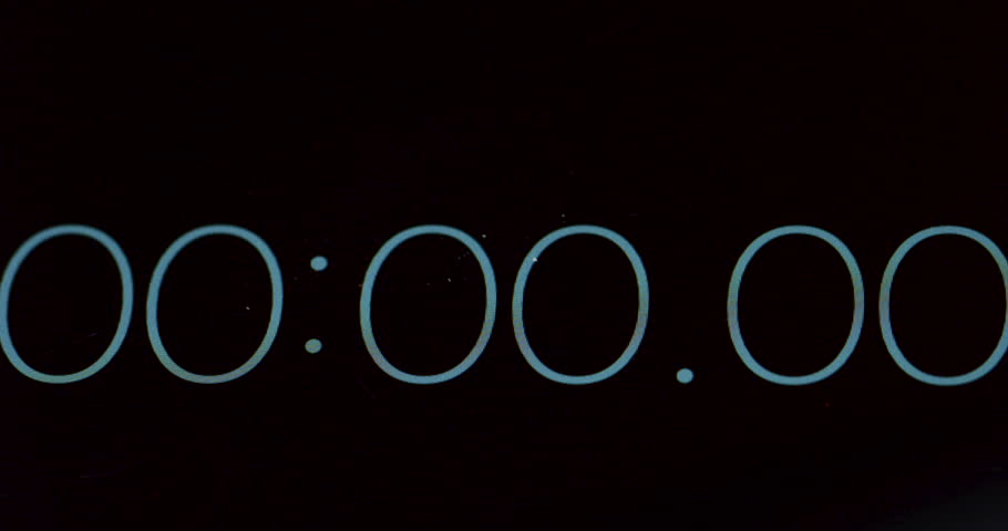 Macro of the timer counting seconds from 0 to 26 on the black screen. Close up.