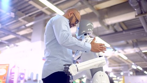 communication robot and human. slow-motion. man hugs a woman robot. Modern Robotic Technologies. They emotions feelings. love robot and human. Futuristic robot. Smart robotic technology virtual love
