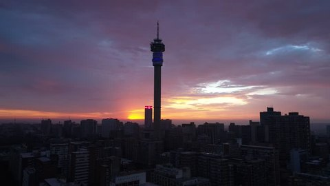 Early morning drone shot of a beautiful sunrise over Johannesburg iconic city skyline