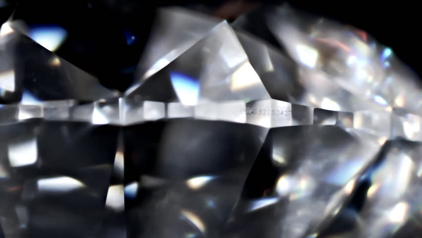 Diamond with GIA number . Diamond with real dispersion on a black background, extreme close up.