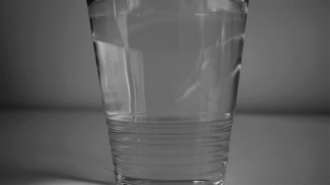 glas of water with black color in it