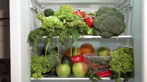Closeup of full fridge, fresh and colorful vegetables in the refrigerator, rich nutrition food