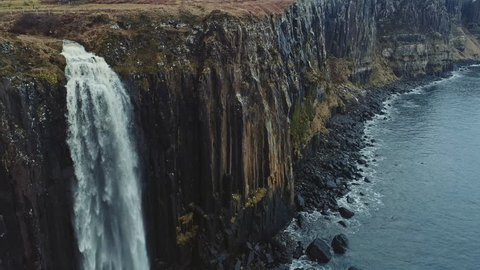 Aerial reveal of Kilt Rock and Mealt Falls from the Isle of Skye in Scotland, UK