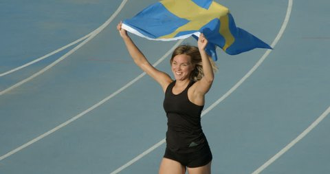 A Swedish Athlete Flying the Flag for Sweden.
