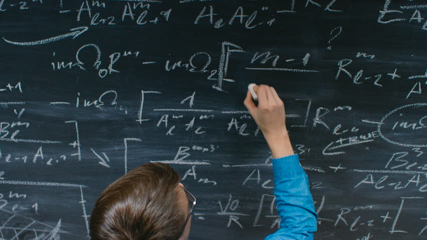 High-Angle Shot of a Brilliant Young Student Writing Big Sophisticated Mathematical Formula/ Equation on the Blackboard. Shot on RED EPIC-W 8K Helium Cinema Camera.