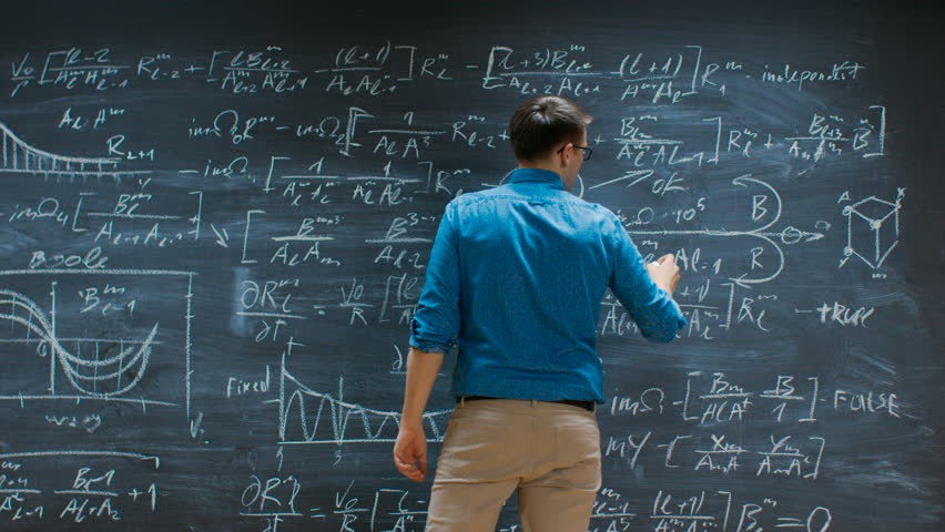 Brilliant Young Mathematician Approaches Big Blackboard and Thinks about Solving Long and Complex Equation/ Formula. Shot on RED EPIC-W 8K Helium Cinema Camera.