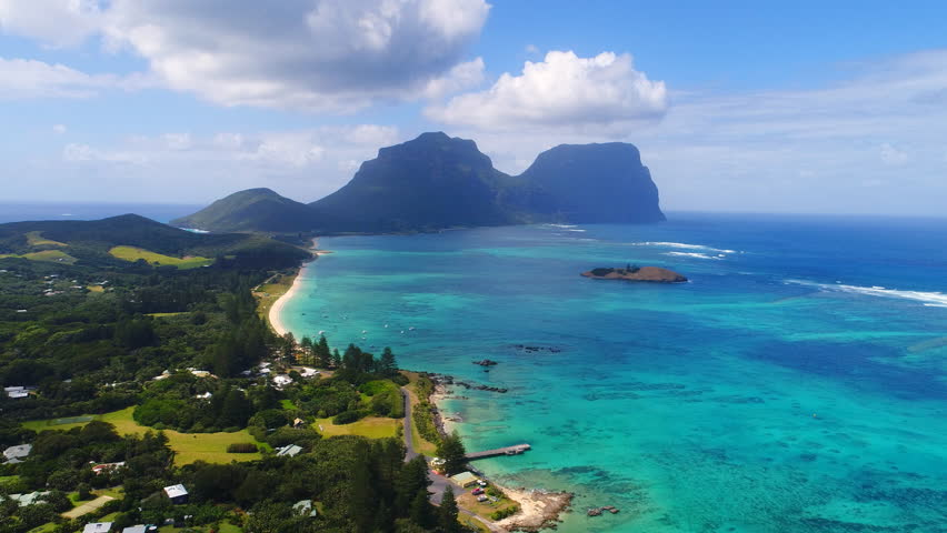 Aerial view of Lord Howe Island (World Heritage-listed paradise), main lagoon and Mount Gower on background - New South Wales - Tasman Sea - Australia from above | Shutterstock HD Video #1008067192