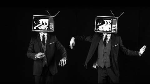 mr tv head. cool man in a suit dancing with a television as a head. the tv is has video static and noise playing on it.