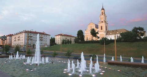 Grodno, Belarus. Fountain In Front Of Bernardine Monastery In Evening Time.
