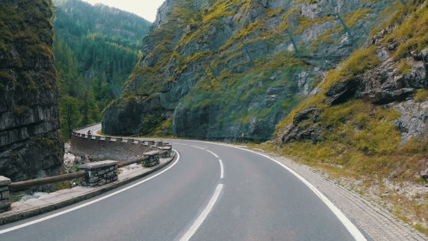 Motorcyclist Rides on a Beautiful Landscape Mountain Road in Austria. First-person view. POV.  | Shutterstock HD Video #1008113092