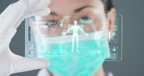 A futuristic doctor with syringe withdraws a liquid medicine and appears a hologram of a planet. Concept: medicine in the world, medical care, future, global competitor pharmaceutical companies.