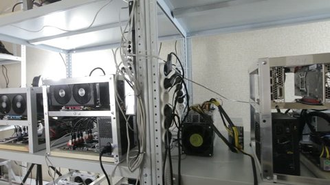 room with farms with video cards, line adapter, and motherboard.