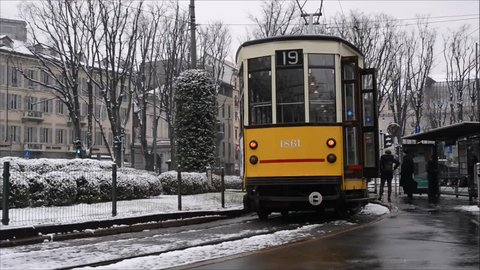 Milan, Italy - Mar 1st, 2018: 30 seconds of vintage 1930s tram in Cordusio, Milan, Lombardy, Italy during winter with Milanese local going about their business. Short scene of man arguing with driver