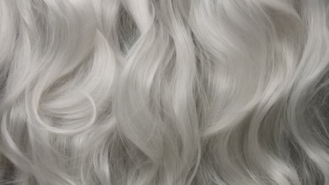 Curly large white grey eldery hair moving slowly 24 fps from 60fps