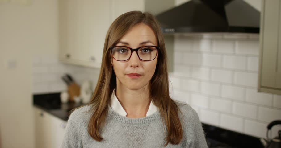 4K Cute girl wearing glasses chattering excitedly during video conference call