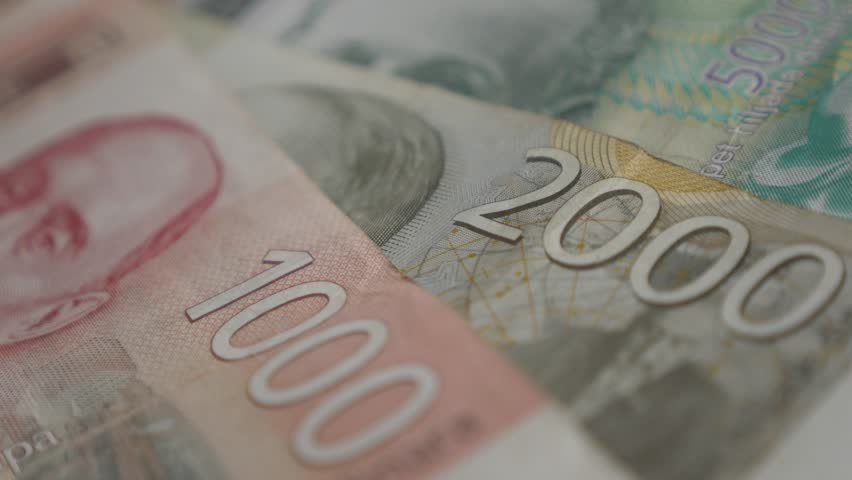 Mixed denominations of dinar shallow DOF 4K 2160p 30fps UltraHD panning   footage - Lot of Serbian banknotes on pile slow pan 3840X2160 UHD video