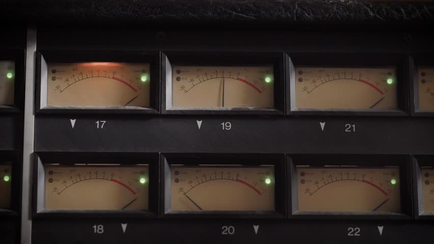 Old displays of professional analog vu metres in a recording studio, measuring and showing decibels