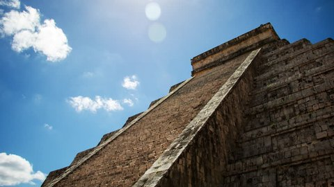 Time lapse of Chichen Itza  pyramid time lapse found in Yucatan Mexico. Kukulkan temple used for human sacrifices is now one of the seven wonders of the ancient world.