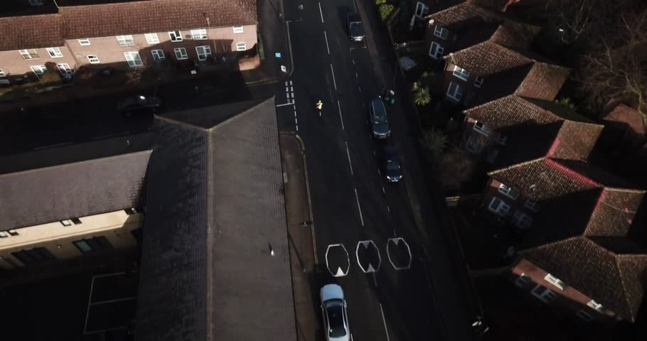 Aerial drone footage following traffic on a sunny day in south London, England.  Good establishing shot or concept shot with regards to commuting or driving.